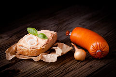Sandwich with meat spread. Fresh polish sandwich with meat spread. Pate composition taken on rustic wooden table stock image