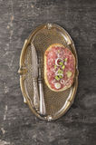 Sandwich with meat tartare in vintage tray. Top view,copy space Stock Image