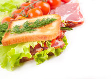 Sandwich from meat and tomatoes Royalty Free Stock Photography