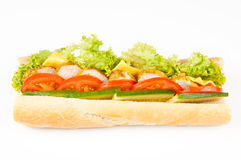 Sandwich with meat, tomatoes, cucumbers. Long sandwich with meat, tomatoes, cucumbers and lettuce. Isolated on white Royalty Free Stock Photos