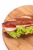Sandwich met de sla van de hamkaas op de houten raad met exemplaarruimte stock fotografie