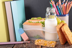 Sandwich,milk and book Stock Image