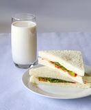 Sandwich and milk glass. Royalty Free Stock Images