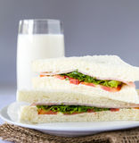 Sandwich and milk glass. Royalty Free Stock Image
