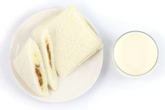 Sandwich and milk. Sanwich and a glass of milk on white background Royalty Free Stock Photography