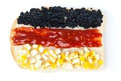 Sandwich mit einer Markierungsfahne des Deutschlands Stockfoto