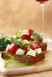 Sandwich with mozzarella and tomatoes Stock Photos