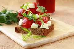 Sandwich with mozzarella and tomatoes Stock Photography