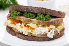 Sandwich Of Rye Bread With Coleslaw And Baked Meat, Close-up Stock Photo