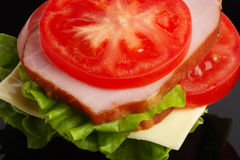 Sandwich On A Black Plate. Variant Two. Stock Photos
