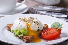 Sandwich with open poached egg and coffee Stock Photos