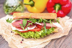 Sandwich with parma. Arugula tomatoes and salad Royalty Free Stock Image