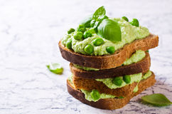 Sandwich with pea puree. Sandwich with green pea puree and basil. Selective focus Royalty Free Stock Photo