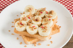 Sandwich with peanut butter and banana and muesli crisp with ber Royalty Free Stock Photography
