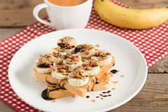 Sandwich peanut butter with banana and muesli crisp with milk te Royalty Free Stock Photos