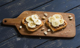 Sandwich with peanut butter, banana and peanuts, served on the Board Stock Photo