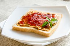 Sandwich with peanut butter and strawberry jelly Stock Photos