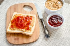 Sandwich with peanut butter and strawberry jelly Stock Photography