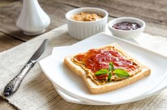 Sandwich with peanut butter and strawberry jelly Royalty Free Stock Photo