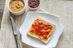 Sandwich with peanut butter and strawberry jelly Royalty Free Stock Photography