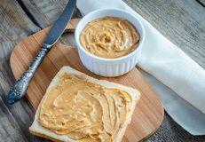 Sandwich with peanut butter on the wooden board Royalty Free Stock Photo