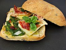 Sandwich with pesto. Prosciutto,cheese and sundried tomatoes Stock Images