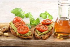 Sandwich with pesto and roasted tomatoes Stock Photo