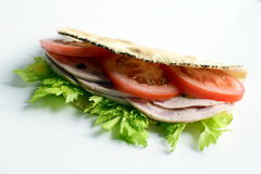 Sandwich. Piadina sandwich with tomato, celery and italian sausage mortadella, isolated Stock Image