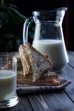 Sandwich and pitcher of milk Royalty Free Stock Photos