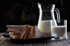 Sandwich and pitcher of milk Royalty Free Stock Photography