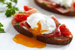 Sandwich with poached egg Royalty Free Stock Photos