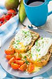 Sandwich with poached egg and cherry tomatoes Royalty Free Stock Photo