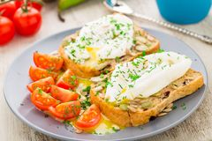 Sandwich with poached egg and cherry tomatoes Stock Image