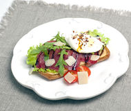 Sandwich with poached eggs and jamon Royalty Free Stock Photos