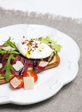 Sandwich with poached eggs and jamon Royalty Free Stock Images