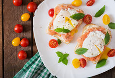 Sandwich with poached eggs with salmon Stock Photos