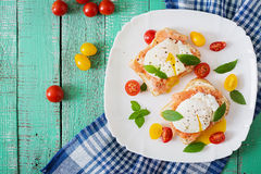 Sandwich with poached eggs with salmon. And cream cheese. Top view Stock Images