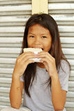 Sandwich. Poor homeless girl happy with a sandwich Stock Photo