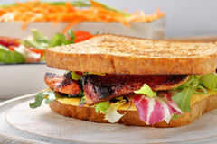 Sandwich with pork cheese and carrots salad Royalty Free Stock Photo