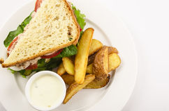 Sandwich with potatoes. And white sauce Stock Images
