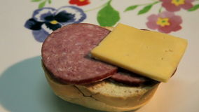 Sandwich. Preparation of sandwich with sausage and cheese stock video footage