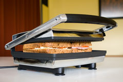 Sandwich press. In use in modern kitchen Stock Image