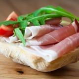 Sandwich with prosciutto. And arugula stock image
