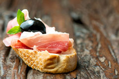 Sandwich with prosciutto olive on wooden old table horizontal Royalty Free Stock Images