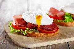 Sandwich with prosciutto and poached egg Royalty Free Stock Image