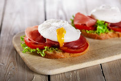 Sandwich with prosciutto and poached egg Royalty Free Stock Photo