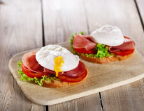 Sandwich with prosciutto and poached egg Royalty Free Stock Photography