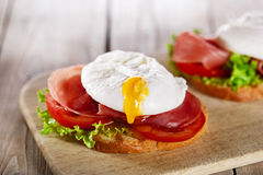 Sandwich with prosciutto and poached egg Stock Photos