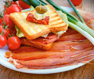 Sandwich with prosciutto and prosciutto on plate Stock Photos