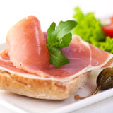 Sandwich with prosciutto and rocket Stock Photography